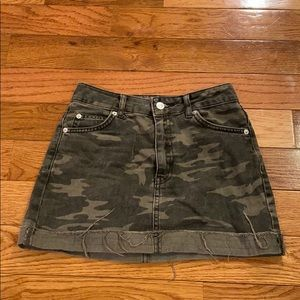 Distress fold camo denim skirt